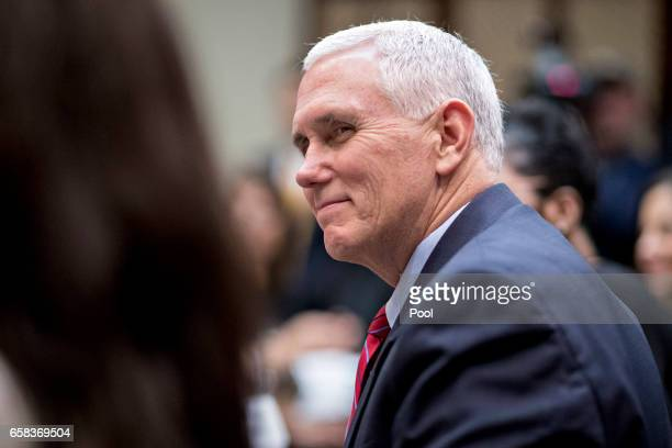 S Vice President Mike Pence listens while meeting with women small business owners with US President Donald Trump not pictured in the Roosevelt Room...