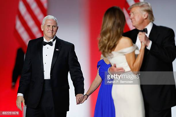 Vice President Mike Pence looks on as President Donald Trump and first lady Melania Trump dance at the Freedom Inaugural Ball at the Washington...