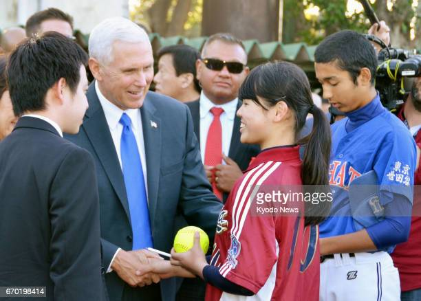 US Vice President Mike Pence meets with Japanese junior and senior high school students who play baseball and softball in Tokyo on April 19 2017...
