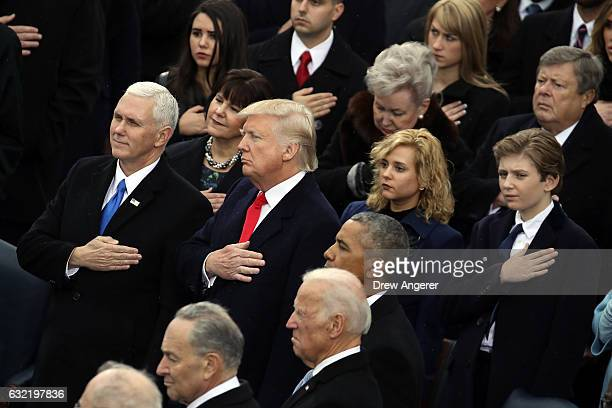 Vice President Mike Pence President Donald Trump and Barron Trump listen to the National Anthem on the West Front of the US Capitol on January 20...
