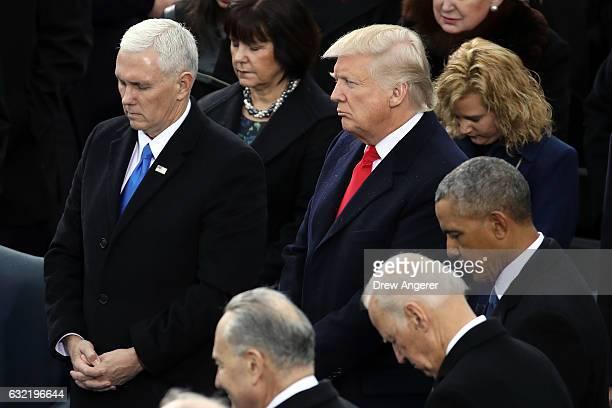 Vice President Mike Pence President Donald Trump former Vice President Joe Biden and former President Barack Obama listen to the inaugural program on...