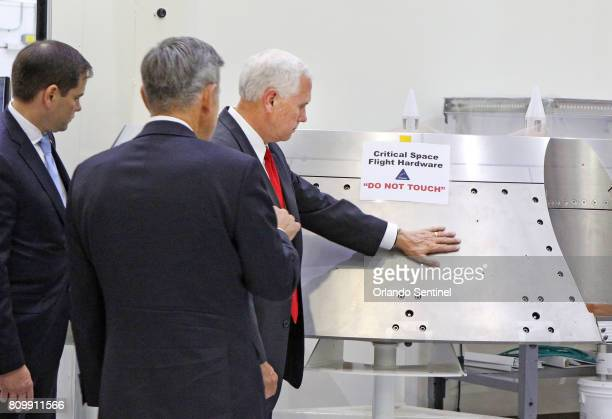 Vice President Mike Pence right gets a tour of the Orion clean room with Sen Marco Rubio left by Bob Cabana Director Kennedy Space Center center...