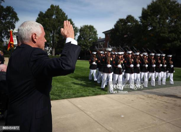 S Vice President Mike Pence salutes passing Marines as he participates in a ceremony to commemorate the anniversary of the 1983 bombing of the Marine...