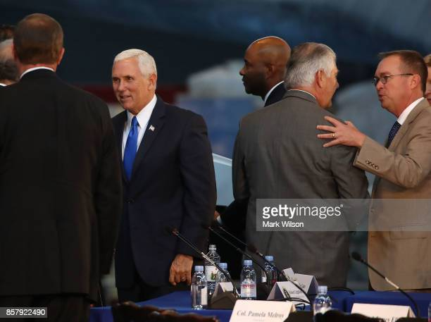 Vice President Mike Pence Secretary of State Rex Tillerson and Director of the Office of Management and Budget Mick Mulvaney talk to guests at the...