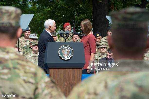 US Vice President Mike Pence shakes hands with Estonia's President Kersti Kaljulaid as he visits NATO's Enhanced Forward Presence mission and...