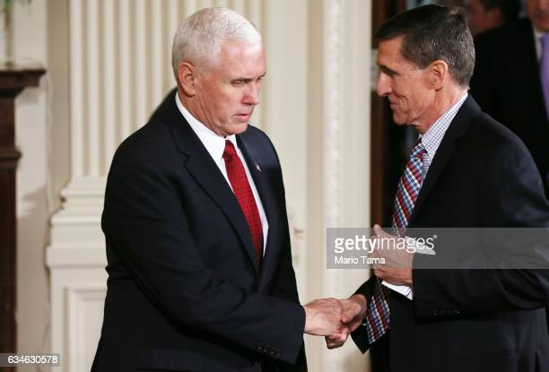 Vice President Mike Pence shakes hands with National Security Adviser Michael Flynn before US President Donald Trump and Japanese Prime Minister...