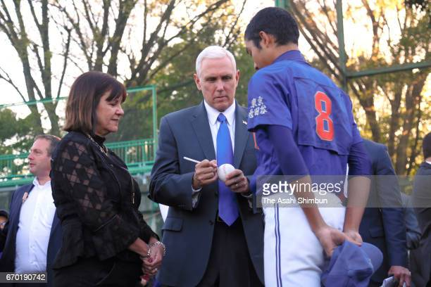 US Vice President Mike Pence signs auntographs for a participant while his wife Karen Pence watches during a youth baseball and softball clinic on...
