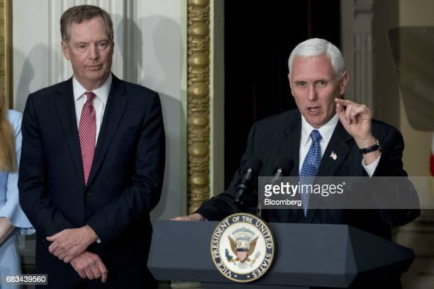 US Vice President Mike Pence speaks as Robert Lighthizer US trade representative left listens before being sworn in during a ceremony in the Indian...