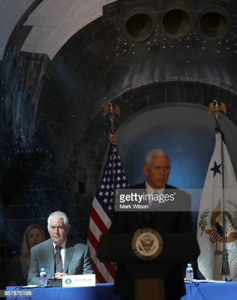 Vice President Mike Pence speaks as Secretary of State Rex Tillerson listens during the inaugural meeting of the National Space Council titled...