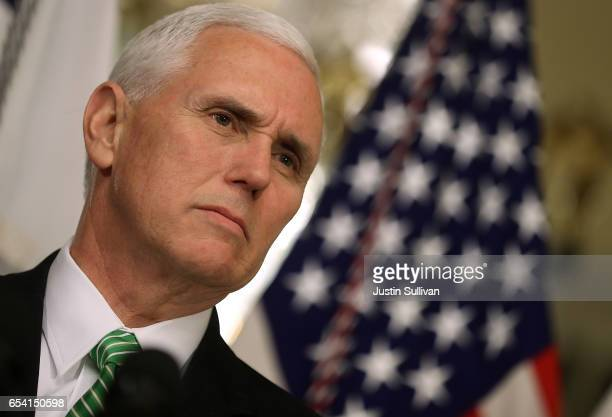 S Vice President Mike Pence speaks to reporters during a swearingin ceremony for National Security Director Dan Coats at the US Capitol on March 16...