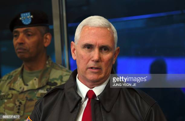 US Vice President Mike Pence speaks to the media as US General Vincent K Brooks Commander of the United Nations Command Combined Forces Command and...