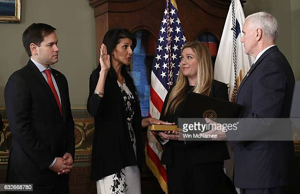 US Vice President Mike Pence swears in Nikki Haley as the US Ambassador to the United Nations January 25 2017 in Washington DC Haley was formerly the...