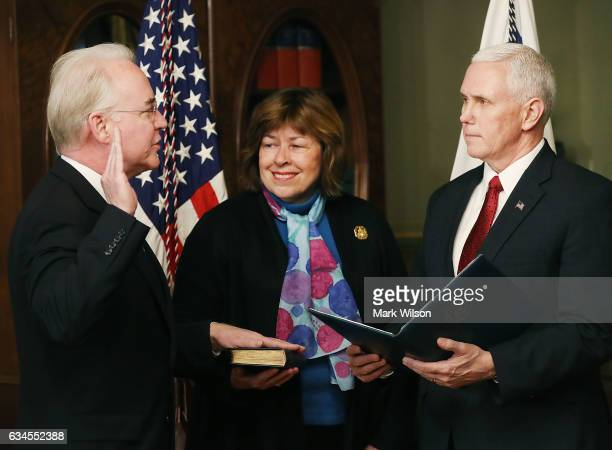 S Vice President Mike Pence swears in Rep Tom Price as new the Health and Human Services Secretary as his wife Betty Price holds a bible on February...