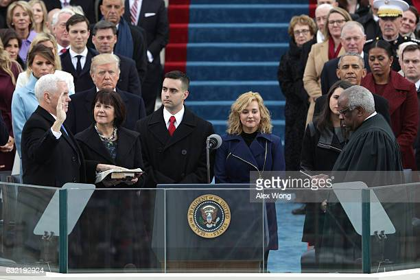 Vice President Mike Pence takes the oath of office from Supreme Court Clarence Thomas as wife Karen Pence holds a bible on the West Front of the US...