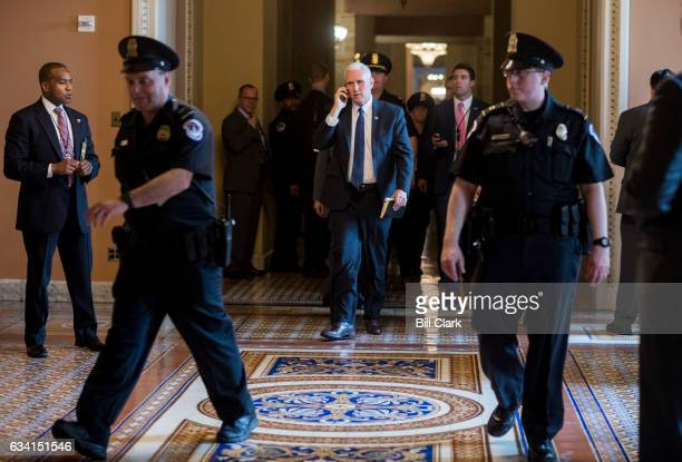 Vice President Mike Pence talks on his cell phone outside of the Senate Republicans' policy lunch in the US Capitol after casting the tie breaking...
