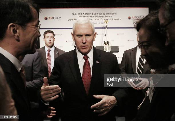 S Vice President Mike Pence talks with members of the American Chamber of Commerce at the Grand Hyatt Hotel on April 18 2017 in Seoul South Korea...