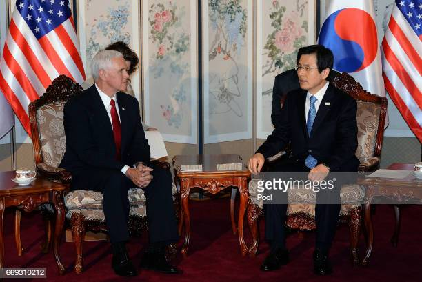 US Vice President Mike Pence talks with South Korean acting president and prime minister Hwang Kyoahn during their meeting on April 17 2017 in Seoul...