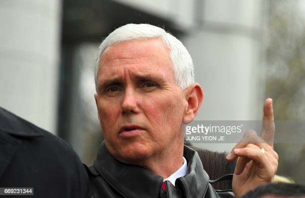 US Vice President Mike Pence visits the truce village of Panmunjom in the Demilitarized Zone on the border between North and South Korea on April 17...
