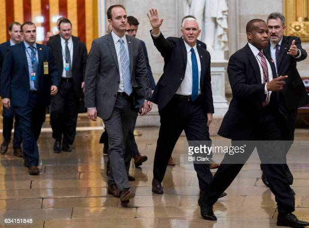 Vice President Mike Pence walks through the Rotunda of the US Capitol after casting the tie breaking vote on the confirmation of Betsy Devos to be...
