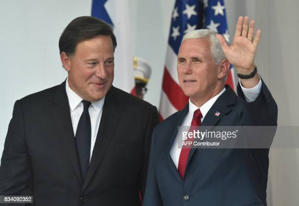 US' Vice President Mike Pence waves next to Panama's President Juan Carlos Varela after delivering a press conference at the Las Garzas Palace in...