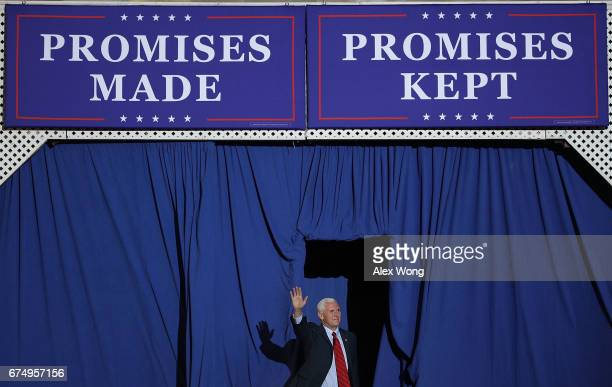 S Vice President Mike Pence waves to supporters during a 'Make America Great Again Rally' at the Pennsylvania Farm Show Complex Expo Center April 29...