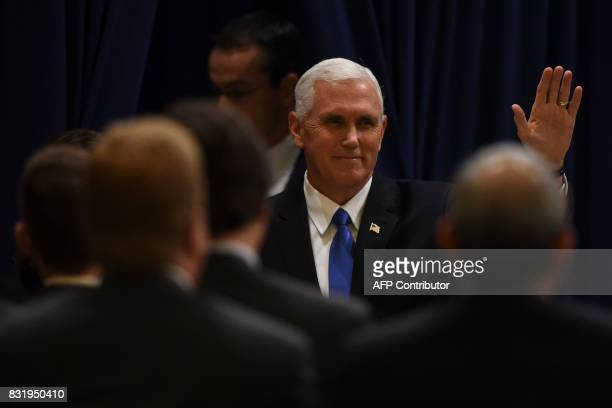 US Vice President Mike Pence waves upon arriving at the Buenos Aires Stock Exchange on August 15 2017 Pence arrived in Argentina for a 24hour...