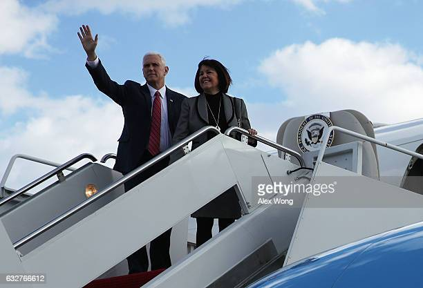 S Vice President Mike Pence waves with his wife Karen before they board Air Force Two January 26 2017 at Joint Base Andrews in Maryland Vice...