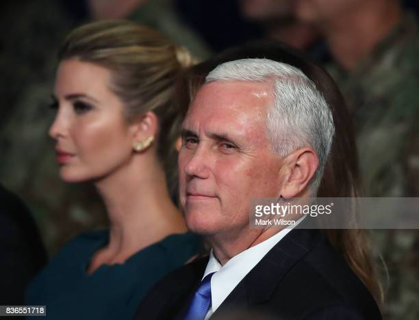 S Vice President Mike Pense sits with Ivanka Trump as President Donald Trump delivers remarks on AmericaN involvement in Afghanistan at the Fort Myer...