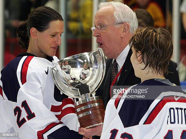 Vice President Murray Costello presents the Championships trophy to US captain Cammi Granato and assistant captain Jenny Potter after the USA beat...