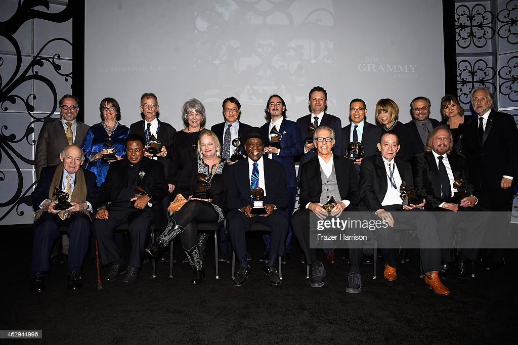 Vice President of Awards for The Recording Academy Bill Freimuth, honoree Martha Gilmer, Recording artist Charlie 'Sonny' Louvin Jr., Denise Holleman, honoree Ray Kurzweil, recording artist Dhani Harrison, Adam Gibb, honoree Jared Cassedy, honoree Cynthia Weil, honoree Barry Mann, Chair of the Board of Trustees for The Recording Academy Christine Albert, President/CEO of The Recording Academy and GRAMMY Foundation President/CEO Neil Portnow and (front, L-R) honoree George Wein, honoree Wayne Shorter, recording artist Kathy Louvin, honoree Buddy Guy, honoree Richard Perry, honoree Flaco Jimenez, and honoree Barry Gibb attend The 57th Annual GRAMMY Awards - Special Merit Awards Ceremony on February 7, 2015 in Los Angeles, California.