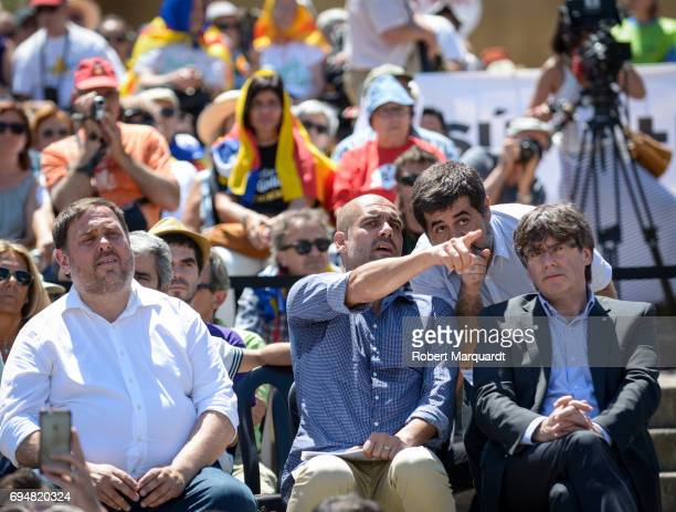 Vice President of Catalunya Oriol Junqueras Pep Guardiola Jordi Sanchez and President of Catalunya Carles Puigdemont attend a rally in support of a...