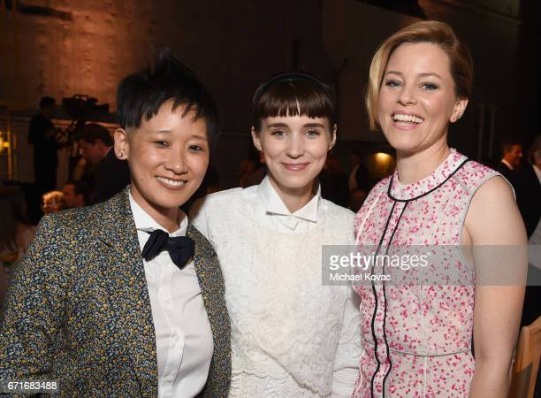 Vice President of Celebrity and Entertainment Outreach for The HSUS Michelle Cho actors Rooney Mara and Elizabeth Banks at The Humane Society of the...