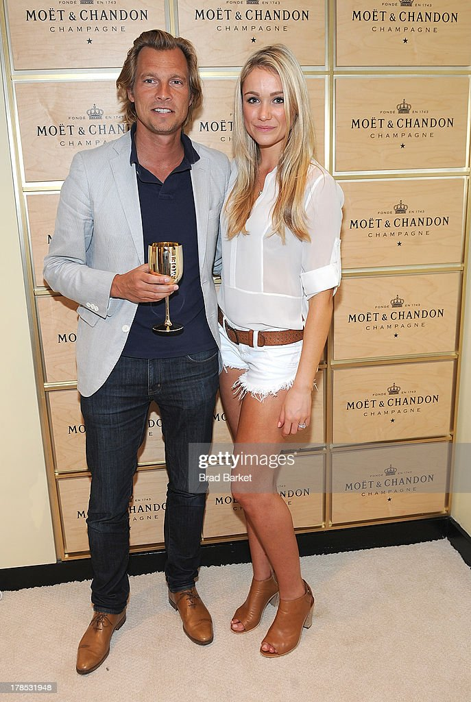 U.S. vice president of Champagne maker Moet & Chandon Ludovic du Plessis(L) and Actor Katrina Bowden attend The Moet & Chandon Suite at USTA Billie Jean King National Tennis Center on August 29, 2013 in New York City.