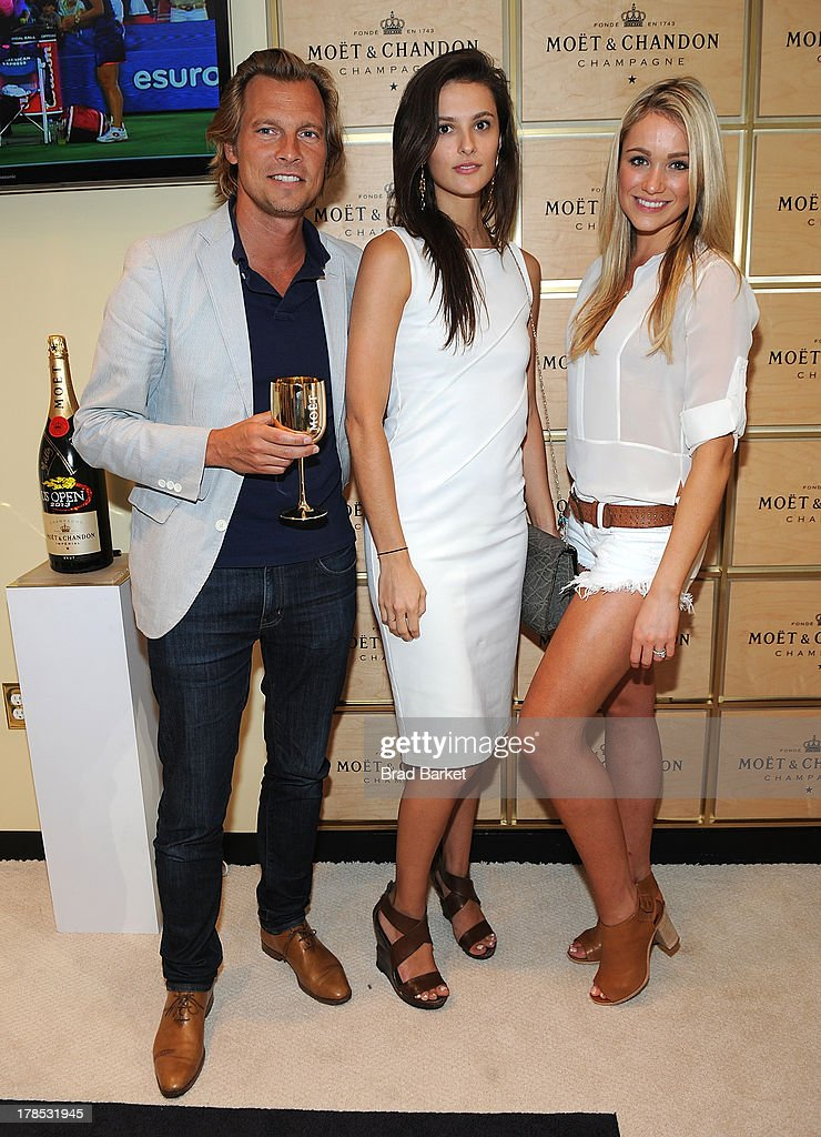 U.S. vice president of Champagne maker Moet & Chandon Ludovic du Plessis, Caroline Byron and Actor <a gi-track='captionPersonalityLinkClicked' href=/galleries/search?phrase=Katrina+Bowden&family=editorial&specificpeople=4272761 ng-click='$event.stopPropagation()'>Katrina Bowden</a> attend The Moet & Chandon Suite at USTA Billie Jean King National Tennis Center on August 29, 2013 in New York City.