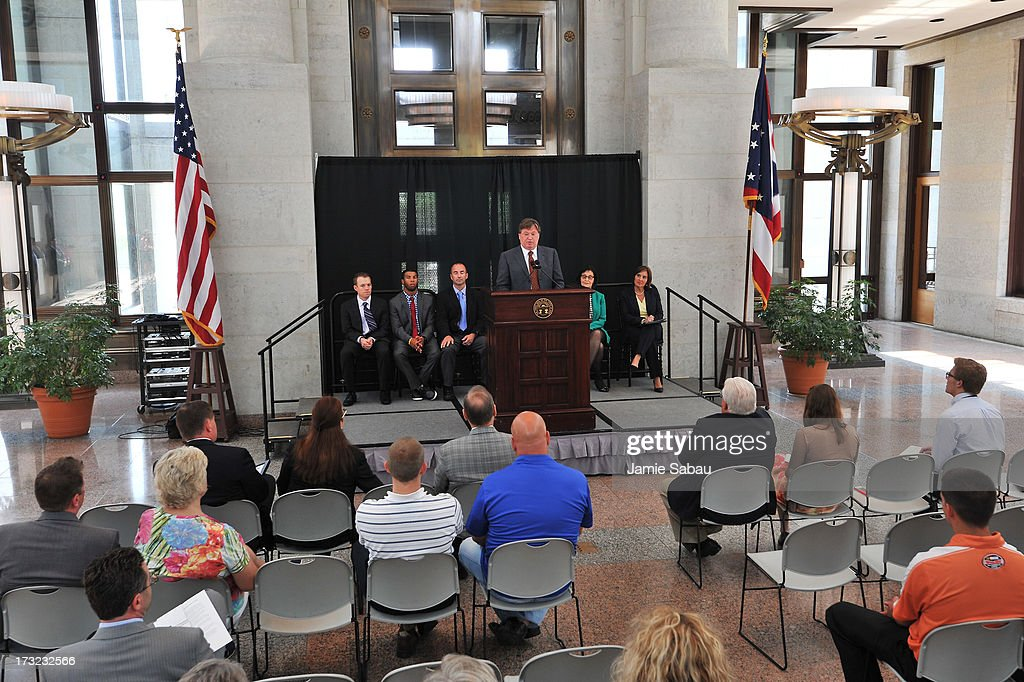 Vice President of Competition Robin Pemberton speaks at a ceremony proclaiming the day NASCAR Day in Ohio at the Ohio Statehouse on July 10, 2013 in Columbus, Ohio. Behind him, left to right, are drivers <a gi-track='captionPersonalityLinkClicked' href=/galleries/search?phrase=Regan+Smith&family=editorial&specificpeople=564271 ng-click='$event.stopPropagation()'>Regan Smith</a>, Darrell Wallace, and <a gi-track='captionPersonalityLinkClicked' href=/galleries/search?phrase=Marcos+Ambrose&family=editorial&specificpeople=179434 ng-click='$event.stopPropagation()'>Marcos Ambrose</a>.