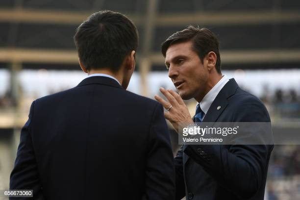 Vice President of FC Internazionale Javier Zanetti talks with FC Internazionale board member Steven Zhang Kangyang prior to he Serie A match between...