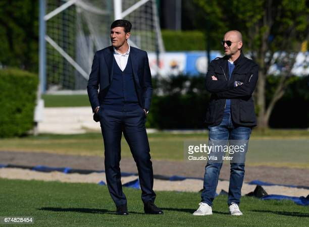 Vice President of FC Internazionale Milano Javier Zanetti and Sporting Director Piero Ausilio look on during FC Internazionale training session at...