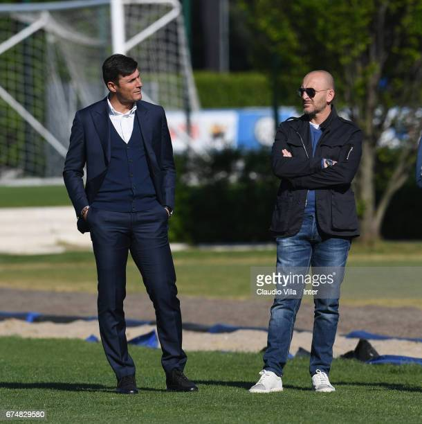 Vice President of FC Internazionale Milano Javier Zanetti and Sporting Director Piero Ausilio chat during FC Internazionale training session at...