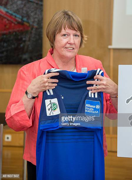 Vice President of German Football Association Hannelore Ratzeburg shows the new logo and jersey during the Women's Bundesliga Manager Meeting at DFB...