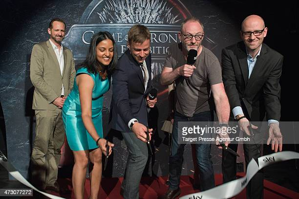 Vice president of HBO Connie Sarvanandan Tom Wlaschiha Liam Cunningham and Peter Tauber attend the pre opening party of the exhibition 'Game of...