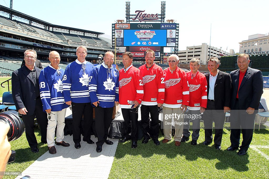 Vice President of Hockey Operations for the Toronto Maple Leafs, Dave Poulin, Toronto Maple Leafs Alumni members Jim McKenny, Kevin Maguire, <a gi-track='captionPersonalityLinkClicked' href=/galleries/search?phrase=Wendel+Clark&family=editorial&specificpeople=882632 ng-click='$event.stopPropagation()'>Wendel Clark</a>, Detroit Red Wings Alumni members <a gi-track='captionPersonalityLinkClicked' href=/galleries/search?phrase=Dino+Ciccarelli&family=editorial&specificpeople=750713 ng-click='$event.stopPropagation()'>Dino Ciccarelli</a>, Joe Kocur, Alex Delvecchio, Ted Lindsay, Executive Vice President and General Manager of the Detroit Red Wings <a gi-track='captionPersonalityLinkClicked' href=/galleries/search?phrase=Ken+Holland&family=editorial&specificpeople=543234 ng-click='$event.stopPropagation()'>Ken Holland</a>, and President of the Saginaw Spirit and Executive Councel Member of the OHL, Craig Goslin all pose during the NHL Winter Classic-Hockey Town Winter Festival press conference at Comerica Park on July 11, 2012 in Detroit, Michigan.