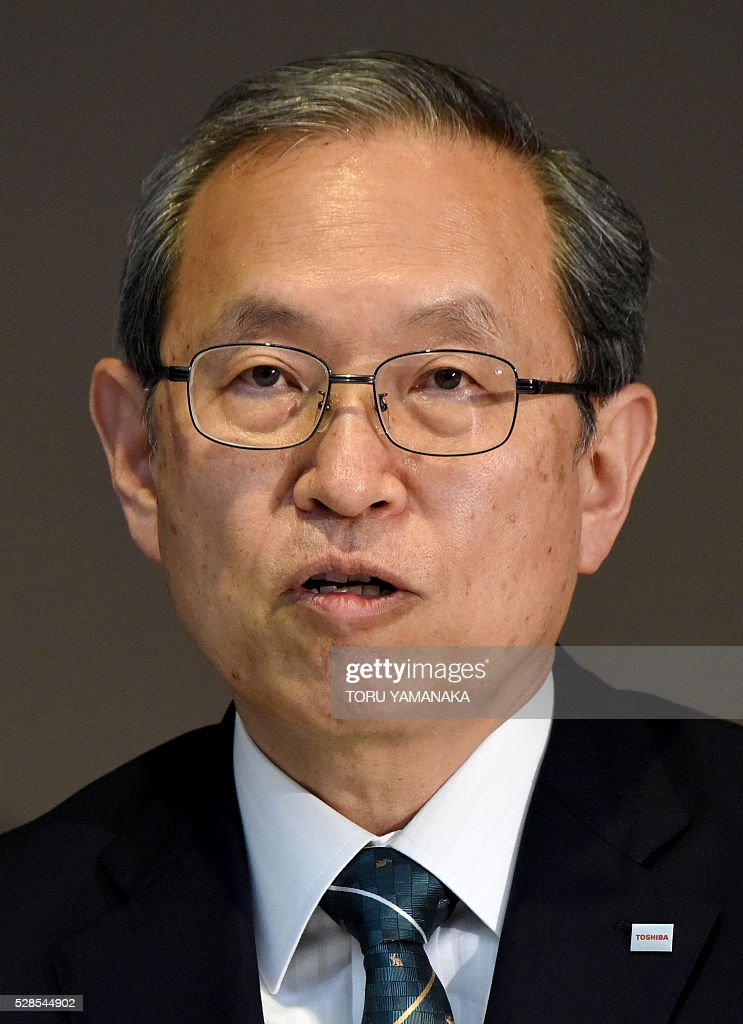 Vice President of Japan's Toshiba Corporation Satoshi Tsunakawa answers questions during a press conference at the headquarters in Tokyo on May 6, 2016. Tsunakawa will assume new Toshiba president after the shareholders meeting in June. / AFP / TORU