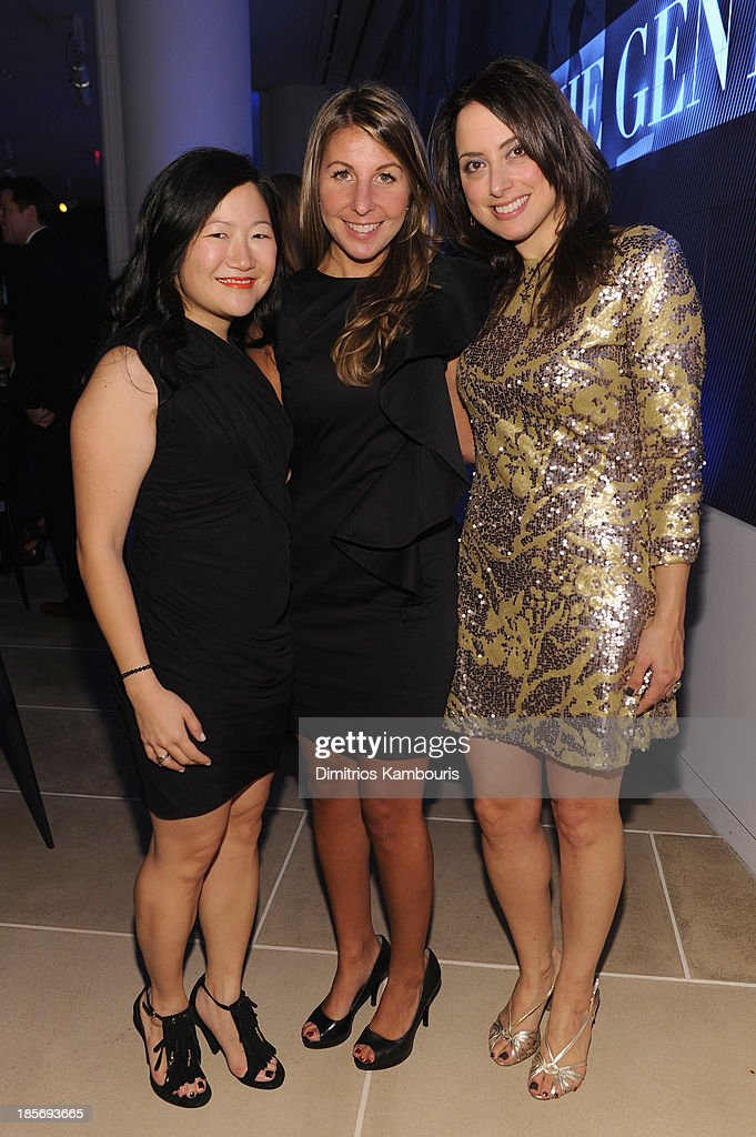 Vice President of Marketing at LACOSTE Emily Lui Coppock (L) poses with guests at the 2013 GQ Gentlemen's Ball presented by BMW i, Movado, and Nautica at IAC Building on October 23, 2013 in New York City.