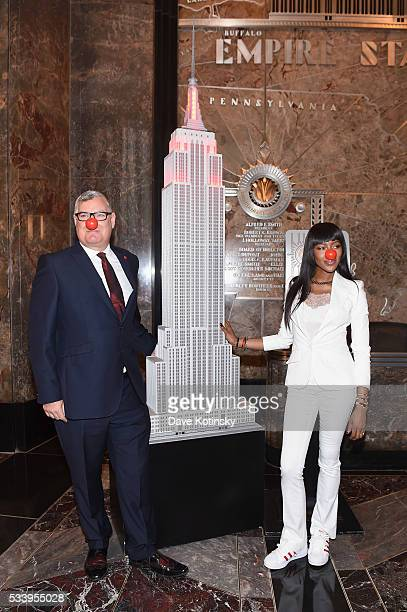 Vice President of Partnerships at Red Nose Day Terry Mills and model Naomi Campbell attend as Naomi Campbell lights the Empire State Building red in...