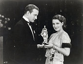 Vice president of the Academy of Motion Picture Arts and Science Conrad Nigel presents the Oscar to Actress Norma Shearer