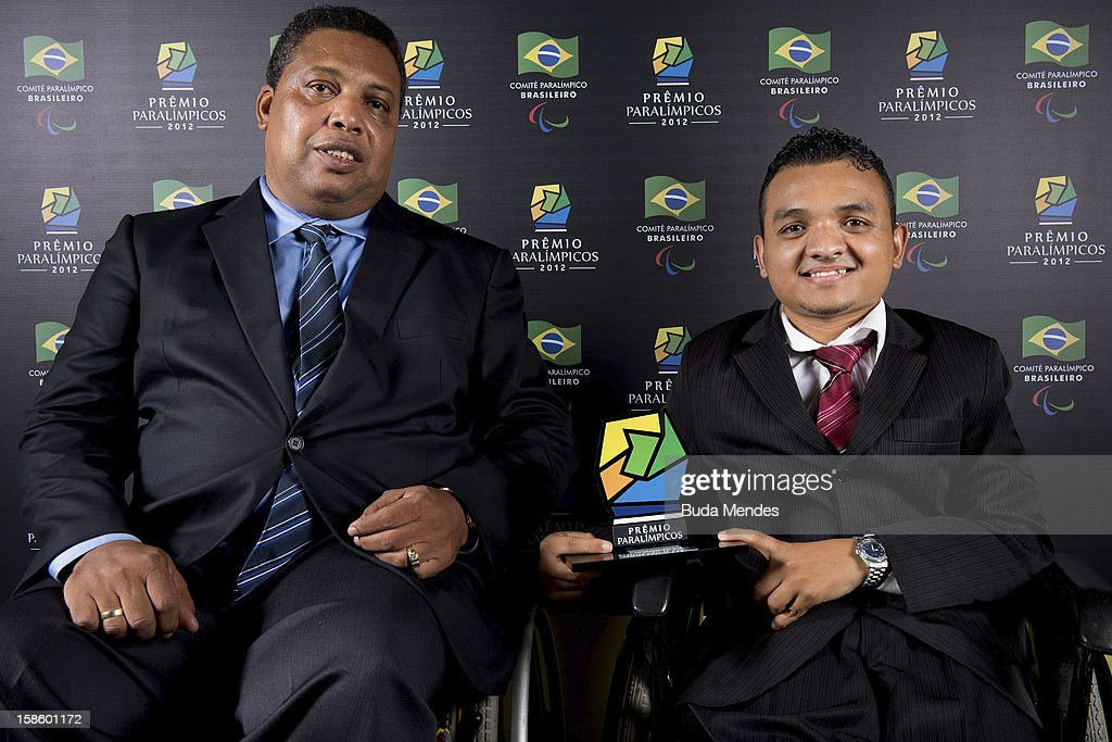 Vice President of the Brazilian Paralympic Committee, Claudio Luiz Pereira and Brazilian Paralympic Maciel de Souza Santos pose for a photo during the ceremony of Paralympics Award 2012 at the Marina da Gloria on December 19, 2012 in Rio de Janeiro, Brazil.