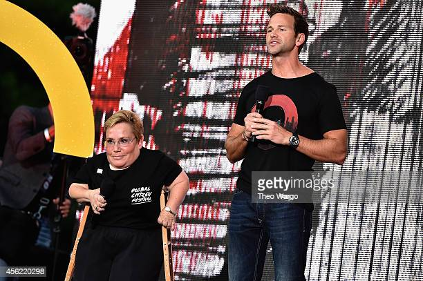Vice President of the Caterpillar Foundation Michele Sullivan and United States Representative Aaron Schock speak onstage at the 2014 Global Citizen...