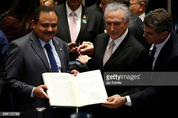 Vice President of the Chamber of Deputies Waldir Maranhão Michel Temer and Romero Juca second vice president of the Senate show the possession book...