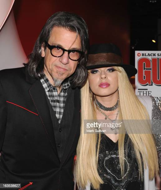 Vice President of the GRAMMY Foundation Scott Goldman and musician Orianthi pose before Great Guitars Orianthi at The GRAMMY Museum on March 11 2013...