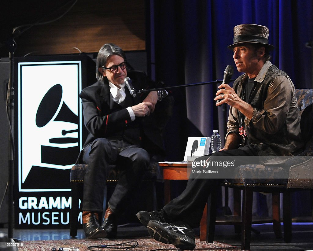 Vice President of the GRAMMY Foundation Scott Goldman (L) and musician Nils Lofgren onstage during An Evening With Nils Lofgren at The GRAMMY Museum on August 5, 2014 in Los Angeles, California.